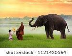 monks buddhism elephant... | Shutterstock . vector #1121420564