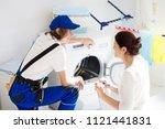 washing machine repair service. ... | Shutterstock . vector #1121441831