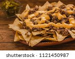 nacho chips corn garnished with ...   Shutterstock . vector #1121450987