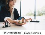 businesswoman calculating... | Shutterstock . vector #1121465411