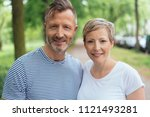 portrait of a happy and... | Shutterstock . vector #1121493281
