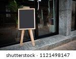 blank black chalk board in... | Shutterstock . vector #1121498147