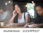 young woman using smartphone ... | Shutterstock . vector #1121499227
