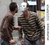 Small photo of AURILLAC, FRANCE - AUGUST 24: two masked dancers, face to face, as part of the Aurillac International Street Theater Festival,show by the Company Idem,on august 24, 2012, in Aurillac,France.