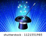 conjurer hat with magic wand on ... | Shutterstock . vector #1121551985
