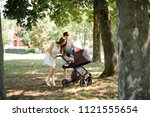 happy and smiling young parents ... | Shutterstock . vector #1121555654