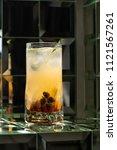 lemonade cocktail on a mirror... | Shutterstock . vector #1121567261