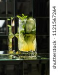 lemonade cocktail on a mirror... | Shutterstock . vector #1121567264