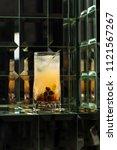 lemonade cocktail on a mirror... | Shutterstock . vector #1121567267