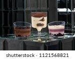 dessert tiramisu in a glass in... | Shutterstock . vector #1121568821
