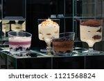 dessert tiramisu in a glass in... | Shutterstock . vector #1121568824