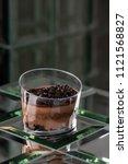 dessert tiramisu in a glass in... | Shutterstock . vector #1121568827