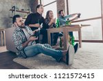 bottom view of four attractive  ... | Shutterstock . vector #1121572415