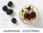 granola  blackberries and... | Shutterstock . vector #1121578361
