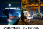 cargo ship is berthing and... | Shutterstock . vector #1121593007