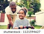 african descent father teaching ... | Shutterstock . vector #1121594627