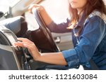 woman driver hand touching the... | Shutterstock . vector #1121603084