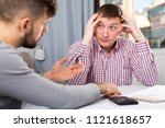 troubled man discussing... | Shutterstock . vector #1121618657
