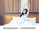 beautiful asian woman waking up ... | Shutterstock . vector #1121646341