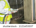 Small photo of Covering a wall by fireproofe refractory composition.