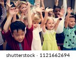 happy kids at elementary school | Shutterstock . vector #1121662694
