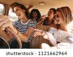 group of friends having fun ... | Shutterstock . vector #1121662964