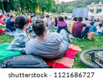 people watching movie in open... | Shutterstock . vector #1121686727