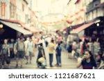 abstract blur .crowds walk... | Shutterstock . vector #1121687621