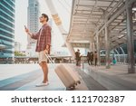 travel tourist standing with... | Shutterstock . vector #1121702387