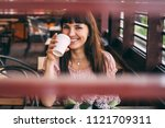 portrait of young smiling woman ... | Shutterstock . vector #1121709311