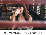 portrait of young woman... | Shutterstock . vector #1121709314