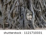 the stone buddha head entwined... | Shutterstock . vector #1121710331