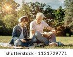 happy together. joyful smiling... | Shutterstock . vector #1121729771