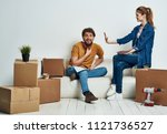 boxes scattered around the room ... | Shutterstock . vector #1121736527