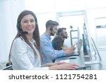 call center employee in the... | Shutterstock . vector #1121754281