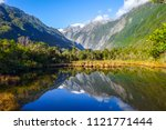 franz josef glacier reflecting...   Shutterstock . vector #1121771444