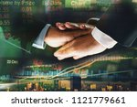 business people joining hands... | Shutterstock . vector #1121779661