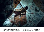 free climber young man climbing ... | Shutterstock . vector #1121787854