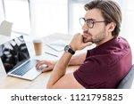 pensive handsome businessman... | Shutterstock . vector #1121795825