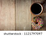 black coffee and donuts on... | Shutterstock . vector #1121797097