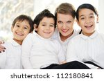 Mother and children at home - stock photo