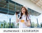 young happy traveler tourist... | Shutterstock . vector #1121816924