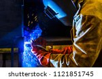 the worker in overalls and a... | Shutterstock . vector #1121851745