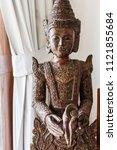 iron bronze buddha in living... | Shutterstock . vector #1121855684