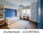 modern kid's room with striped... | Shutterstock . vector #1121907821