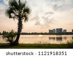 beautiful sunset with lake and...   Shutterstock . vector #1121918351