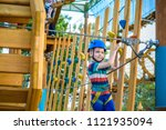 boy having fun at adventure... | Shutterstock . vector #1121935094