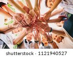 hand pile of smiling adults and ... | Shutterstock . vector #1121940527