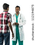 Male Indian Doctor talking to a patient. Isolated on white background. - stock photo