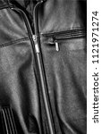 black leather jacket  closeup | Shutterstock . vector #1121971274